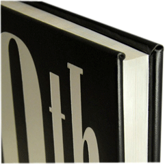Closeup of a book edge-gilt in white foil